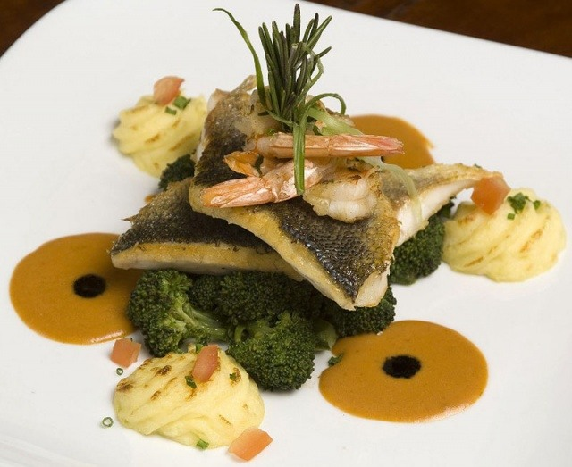 Fish dish on bed of broccoli